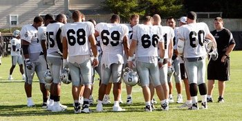 Offensive linemen get instructions for a day of practice.