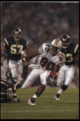 5 Nov 1995:  Wide receiver Irving Fryar #80 of the Miami Dolphins makes his way down field for a touchdown against the San Diego Chargers at Jack Murphy Stadium in San Diego, California.  The Dolphins defeated the Chargers 24-14.  Mandatory Credit:  Allsp
