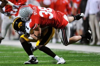 COLUMBUS, OH - NOVEMBER 14:  Linebacker Austin Spitler #38 of the Ohio State Buckeyes tackles wide receiver Marvin McNutt #7 of the Iowa Hawkeyes at Ohio Stadium on November 14, 2009 in Columbus, Ohio.  (Photo by Jamie Sabau/Getty Images)