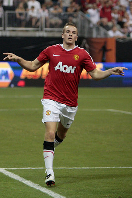 HOUSTON - JULY 28:  Tom Cleverley #35 of Manchester United celebrates a goal in the second half of the MLS All Star Game at Reliant Stadium on July 28, 2010 in Houston, Texas.  (Photo by Bob Levey/Getty Images)