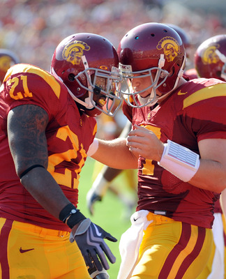 LOS ANGELES, CA - NOVEMBER 14:  Matt Barkley #7 and Allen Bradford #21 of the USC Trojans celebrate a touchdown to trail the Stanford Cardinal 14-7 during the first half at the Los Angeles Memorial Coliseum on November 14, 2009 in Los Angeles, California.