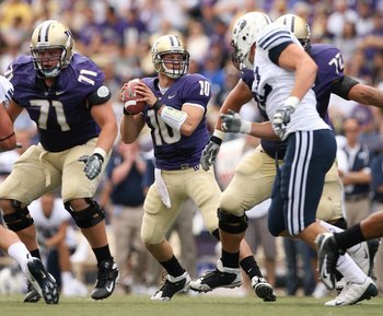 SEATTLE - SEPTEMBER 6:  Jake Locker #10 of the Washington Huskies looks to make a pass play during their game against the BYU Cougars on September 6, 2008 at Husky Stadium in Seattle, Washington. The Cougars defeated the Huskies 28-27. (Photo by Otto Greu