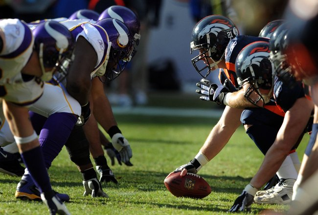DENVER - DECEMBER 30:  Center Chris Myers #62 of the Denver Broncos gets set to snap the ball during the football game against the Minnesota Vikings at Invesco Field at Mile High on December 30, 2007 in Denver, Colorado.  (Photo by Steve Dykes/Getty Image