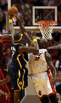 MIAMI - APRIL 13: Jermaine O'Neal #7 of the Indiana Pacers is blocked by Shaquille O'Neal #32 of the Miami Heat on April 13, 2007 at the American Airlines Arena in Miami  Florida. NOTE TO USER: User expressly acknowledges and agrees that, by downloading a