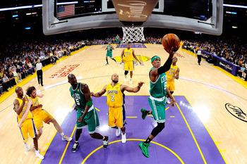 LOS ANGELES, CA - JUNE 17:  Rajon Rondo #9 of the Boston Celtics lays the ball up over Derek Fisher #2 of the Los Angeles Lakers in Game Seven of the 2010 NBA Finals at Staples Center on June 17, 2010 in Los Angeles, California.  NOTE TO USER: User expres