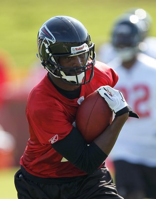 FLOWERY BRANCH, GA - JULY 30:  Michael Jenkins #12 of the Atlanta Falcons runs drills during opening day of training camp on July 30, 2010 at the Falcons Training Complex in Flowery Branch, Georgia.  (Photo by Kevin C. Cox/Getty Images)