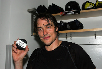 ANAHEIM, CA - MARCH 21:  Teemu Selanne #8 of the Anaheim Ducks holds up the puck with which he scored his 600th career NHL goal against the Colorado Avalanche after their NHL game at the Honda Center on March 21, 2010 in Anaheim, California. The Ducks def
