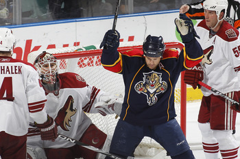 SUNRISE, FL - MARCH 18: Goaltender Ilya Bryzgalov #30 of the Phoenix Coyotes looks up as Cory Stillman #61 of the Florida Panthers celebrates a goal scored by Stephen Weiss (not pictured) on March 18, 2010 at the BankAtlantic Center in Sunrise, Florida. (