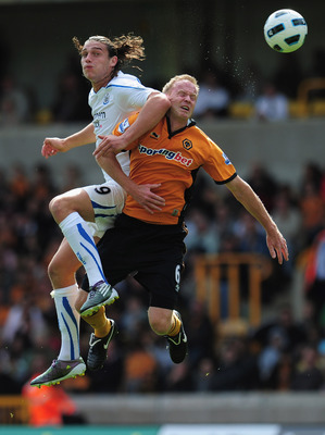 WOLVERHAMPTON, ENGLAND - AUGUST 28:  Andy Carroll of Newcastle United outjumps Jody Craddock of Wolverhampton Wanderers during the Barclays Premier League match between Wolverhampton Wanderers and Newcastle United at Molineux on August 28, 2010 in Wolverh