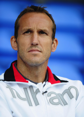 BOLTON, ENGLAND - AUGUST 14:  Mark Schwarzer of Fulham looks on from the stands during the Barclays Premier League match between Bolton Wanderers and Fulham at Reebok Stadium on August 14, 2010 in Bolton, England.  (Photo by Laurence Griffiths/Getty Image