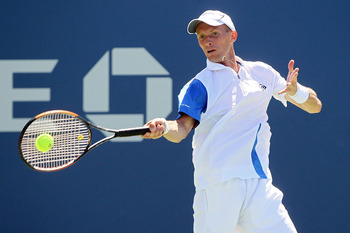 NEW YORK - AUGUST 30:  Nikolay Davydenko of Russia returns a forehand against Michael Russell of the United States during the Men's Singles first round match on day one of the 2010 U.S. Open at the USTA Billie Jean King National Tennis Center on August 30