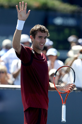 NEW YORK - AUGUST 30:  Marin Cilic of Croatia waves to the crowd after winning match point against Illya Marchenko of the Ukraine during the Men's Singles first round match on day one of the 2010 U.S. Open at the USTA Billie Jean King National Tennis Cent