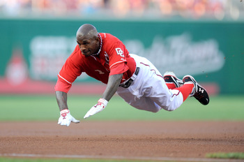 WASHINGTON - JULY 30:  Nyjer Morgan #1 of the Washington Nationals slides into third base with a triple in the first inning against the Philadelphia Phillies at Nationals Park on July 30, 2010 in Washington, DC.  (Photo by Greg Fiume/Getty Images)