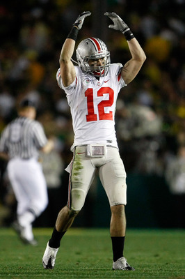 PASADENA, CA - JANUARY 01:  Dane Sanzenbacher #12 of the Ohio State Buckeyes reacts in the fourth quarter against the Oregon Ducks at the 96th Rose Bowl game on January 1, 2010 in Pasadena, California.  (Photo by Jeff Gross/Getty Images)