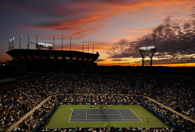 NEW YORK - SEPTEMBER 03:  A general view of the sunset over Arthur Ashe Stadium as Novak Djokovic of Serbia plays Carsten Ball of Australia in Louis Armstrong Stadium during day four of the 2009 U.S. Open at the USTA Billie Jean King National Tennis Cente