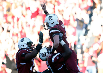 COLUMBIA, SC - NOVEMBER 28:  Stephen Garcia #5 of the South Carolina Gamecocks celebrates a second half touchdown with his temmates against the Clemson Tigers at Williams-Brice Stadium on November 28, 2009 in Columbia, South Carolina.  (Photo by Scott Hal