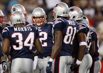 FOXBORO, MA - AUGUST 26:  Tom Brady #12 of the New England Patriots calls the play in the huddle as Sammy Morris #34 and Randy Moss #81 stand by in the first half against the St. Louis Rams on August 26, 2010 at Gillette Stadium in Foxboro, Massachusetts.