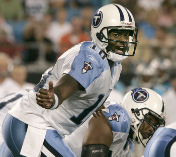 CHARLOTTE, NC - AUGUST 28:  Quarterback Vince Young #10 of the Tennessee Titans signals to his team during their preseason game against the Carolina Panthers at Bank of America Stadium on August 28, 2010 in Charlotte, North Carolina. (Photo by Mary Ann Ch