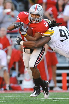 COLUMBUS, OH - NOVEMBER 14:  Tailback Brandon Saine #3 of the Ohio State Buckeyes runs with the ball against the Iowa Hawkeyes at Ohio Stadium on November 14, 2009 in Columbus, Ohio.  (Photo by Jamie Sabau/Getty Images)