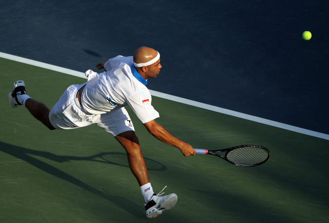 NEW YORK - SEPTEMBER 02:  James Blake of the United States hits a forehand return shot against Peter Polansky of Canada during his men's singles match on day four of the 2010 U.S. Open at the USTA Billie Jean King National Tennis Center on September 2, 20