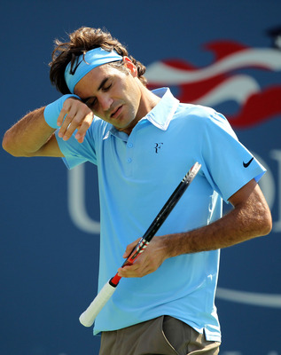 NEW YORK - SEPTEMBER 02:  Roger Federer of Switzerland wipes his head while playing against Andreas Beck of Germany during the Men's singles on day four of the 2010 U.S. Open at the USTA Billie Jean King National Tennis Center on September 2, 2010 in the