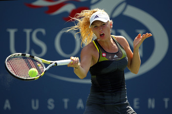 NEW YORK - SEPTEMBER 02:  Caroline Wozniacki of Denmark returns a shot to Kai-Lung Chang of Chinese Taipei during the Women's singles on day four of the 2010 U.S. Open at the USTA Billie Jean King National Tennis Center on September 2, 2010 in the Flushin