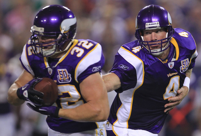 MINNEAPOLIS - AUGUST 28:  Brett Favre #4 of the Minnesota Vikings hands off to Toby Gerhart #32 against the Seattle Seahawks during a preseason NFL game at Mall of America Field at the Hubert H. Humphrey Metrodome on August 28, 2010  in Minneapolis, Minne