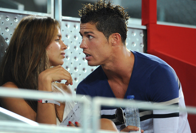 MADRID, SPAIN - AUGUST 22:  Cristiano Ronaldo (R) of Real Madrid chats with Irina Shayk while enjoying a friendly basketbal game between Spain and the USA at La Caja Magica on August 22, 2010 in Madrid, Spain.  (Photo by Jasper Juinen/Getty Images)