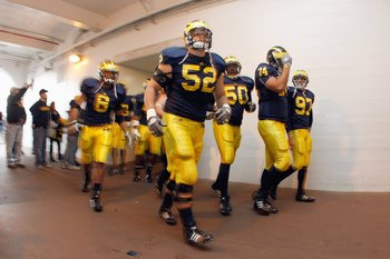 ANN ARBOR, MI - NOVEMBER 21: Kevin Leach #52 of the Michigan Wolverines jogs through the tunnel before the game against the Ohio State Buckeyes on November 21, 2009 at Michigan Stadium in Ann Arbor, Michigan. Ohio State won the game 21-10. (Photo by Grego