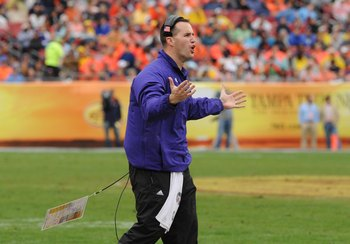 TAMPA, FL - JANUARY 1: Coach Pat Fitzgerald of the Northwestern Wildcats questions a call against the Auburn Tigers in the Outback Bowl January 1, 2010 at Raymond James Stadium in Tampa, Florida.  (Photo by Al Messerschmidt/Getty Images)
