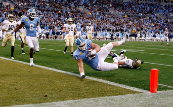 CHARLOTTE, NC - DECEMBER 26:  Aaron Berry #17 of the Pittsburgh Panthers misses a tackle on Zack Pinalto #17 of the North Carolina Tar Heels during their game on December 26, 2009 in Charlotte, North Carolina.  (Photo by Streeter Lecka/Getty Images)