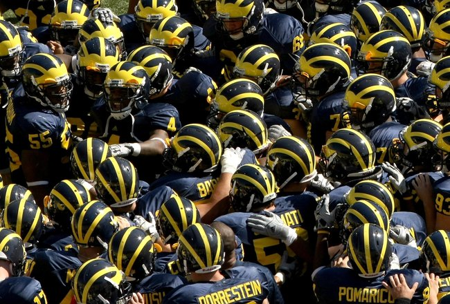 ANN ARBOR, MI - SEPTEMBER 19:  The Michigan Wolverines huddles on the field before the game against the Eastern Michigan Eagles at Michigan Stadium on September 19, 2009 in Ann Arbor, Michigan. Michigan won 45-17.  (Photo by Stephen Dunn/Getty Images)