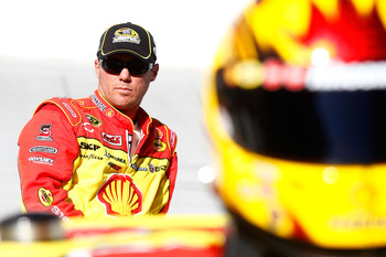 BRISTOL, TN - AUGUST 20:  Kevin Harvick, driver of the #29 Shell/Pennzoil Chevrolet, stands on the grid during qualifying for the NASCAR Sprint Cup Series IRWIN Tools Night Race at Bristol Motor Speedway on August 20, 2010 in Bristol, Tennessee.  (Photo b