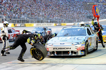 BRISTOL, TN - AUGUST 21:  Carl Edwards, driver of the #99 Aflac Ford, pits during the NASCAR Sprint Cup Series IRWIN Tools Night Race at Bristol Motor Speedway on August 21, 2010 in Bristol, Tennessee.  (Photo by John Harrelson/Getty Images for NASCAR)