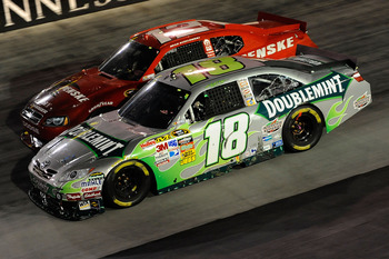 BRISTOL, TN - AUGUST 21:  Kyle Busch, driver of the #18 Doublemint Toyota, and Brad Keselowski, driver of the #12 Penske Dodge, during the NASCAR Sprint Cup Series IRWIN Tools Night Race at Bristol Motor Speedway on August 21, 2010 in Bristol, Tennessee.