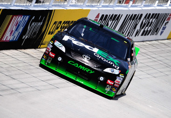 BRISTOL, TN - AUGUST 20:  Denny Hamlin drives the #11 FedEx Ground Toyota during practice for the NASCAR Sprint Cup Series IRWIN Tools Night Race at Bristol Motor Speedway on August 20, 2010 in Bristol, Tennessee.  (Photo by Rusty Jarrett/Getty Images for