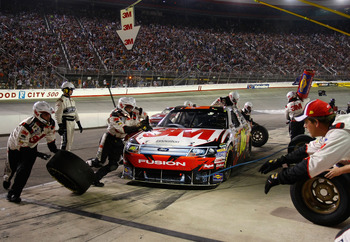 BRISTOL, TN - AUGUST 21:  Greg Biffle, driver of the #16 3M Ford, pits during the NASCAR Sprint Cup Series IRWIN Tools Night Race at Bristol Motor Speedway on August 21, 2010 in Bristol, Tennessee.  (Photo by Geoff Burke/Getty Images for NASCAR)