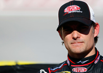BRISTOL, TN - AUGUST 20:  Jeff Gordon, driver of the #24 DuPont Chevrolet, stands on the grid during qualifying for the NASCAR Sprint Cup Series IRWIN Tools Night Race at Bristol Motor Speedway on August 20, 2010 in Bristol, Tennessee.  (Photo by Geoff Bu