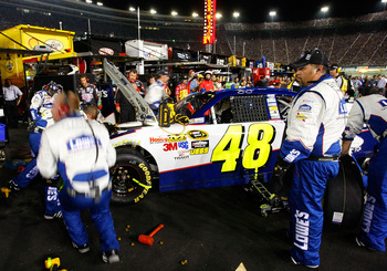 BRISTOL, TN - AUGUST 21:  Crew members work on the wrecked #48 Lowe's Chevrolet, driven by Jimmie Johnson, after an incident on track in the NASCAR Sprint Cup Series IRWIN Tools Night Race at Bristol Motor Speedway on August 21, 2010 in Bristol, Tennessee