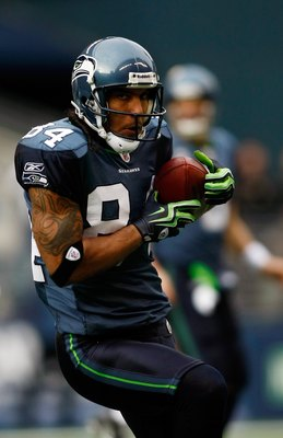 SEATTLE , WA - JANUARY 03:  T.J. Houshmandzadeh #84 of the Seattle Seahawks runs after a catch against the Tennessee Titans at Qwest Field on January 3, 2010 in Seattle, Washington.  (Photo by Jonathan Ferrey/Getty Images)