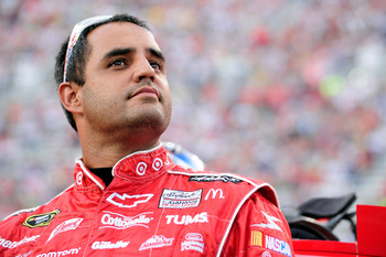 BRISTOL, TN - AUGUST 21:  Juan Pablo Montoya, driver of the #42 Target Chevrolet, stands on the grid prior to the start of the NASCAR Sprint Cup Series IRWIN Tools Night Race at Bristol Motor Speedway on August 21, 2010 in Bristol, Tennessee.  (Photo by J