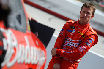 BRISTOL, TN - AUGUST 20:  Kasey Kahne, driver of the #9 Budweiser Ford, stands by his car during practice for the NASCAR Sprint Cup Series IRWIN Tools Night Race at Bristol Motor Speedway on August 20, 2010 in Bristol, Tennessee.  (Photo by Jared C. Tilto