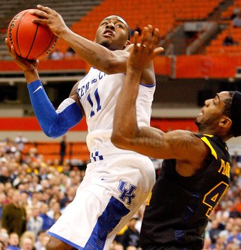 SYRACUSE, NY - MARCH 27:  John Wall #11 of the Kentucky Wildcats drives for a shot attempt against Joh Flowers #41 of the West Virginia Mountaineers during the east regional final of the 2010 NCAA men's basketball tournament at the Carrier Dome on March 2