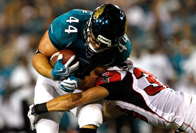 JACKSONVILLE, FL - SEPTEMBER 02:  Brock Bolen #44 of the Jacksonville Jaguars breaks the tackle of Raphael Bush #36 of the Atlanta Falcons to score a touchdown during a preseason game at EverBank Field on September 2, 2010 in Jacksonville, Florida.  (Phot