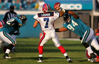 JACKSONVILLE, FL - NOVEMBER 25:  J.P. Losman #7 of the Buffalo Bills is pressured by Jeremy Mincey #94 of the Jacksonville Jaguars November 25, 2007 at Jacksonville Municipal Stadium in Jacksonville, Florida.  The Jaguars beat the Bills 36-14.  (Photo by