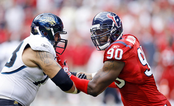 HOUSTON - SEPTEMBER 27:  Offensive tackle Jordan Black #78 of the Jacksonville Jaguars and defensive end Mario Williams #90 of the Houston Texans hook up at Reliant Stadium on September 27, 2009 in Houston, Texas.  (Photo by Bob Levey/Getty Images)