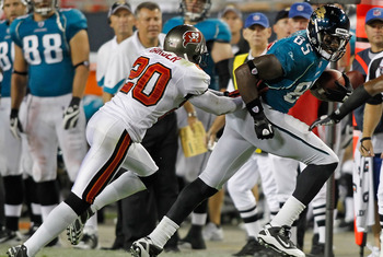 TAMPA, FL - AUGUST 28:  Cornerback Ronde Barber #20 of the Tampa Bay Buccaneers pushes tight end Ernest Wilford #85 of the Jacksonville Jaguars out of bounds during a preseason game at Raymond James Stadium on August 28, 2010 in Tampa, Florida.  (Photo by