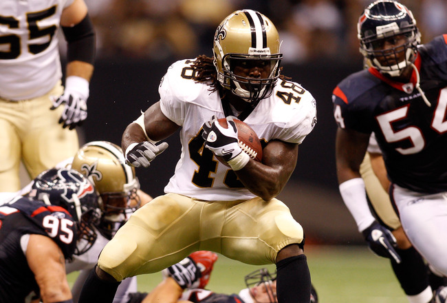 NEW ORLEANS - AUGUST 21:  Chris Ivory #48 of the New Orleans Saints runs the ball against the Houston Texans at the Louisiana Superdome on August 21, 2010 in New Orleans, Louisiana.  (Photo by Chris Graythen/Getty Images)