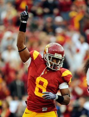 LOS ANGELES, CA - DECEMBER 05: Wide receiver Ronald Johnson #8 of the USC Trojans celebrates his touchdwon against the Arizona Wildcats during the second quarter of the NCAA college football game at the Los Angeles Coliseum on December 5, 2009 in Los Ange