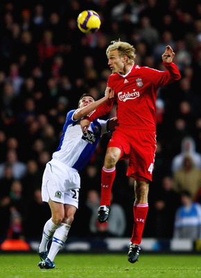 BLACKBURN, UNITED KINGDOM - DECEMBER 06: Sami Hyypia of Liverpool in action with Matt Derbyshire of Blackburn Rovers during the Barclays Premier League match between Blackburn Rovers and Liverpool at Ewood Park on December 6, 2008 in Blackburn, England.